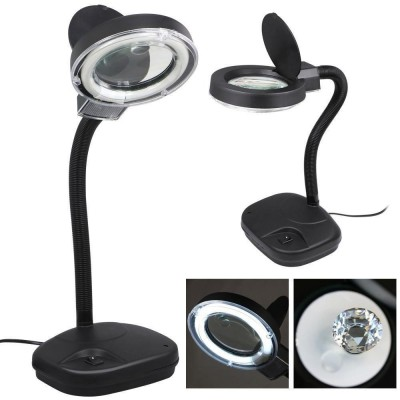 Workbench lamp with magnifier